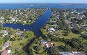 Aerial view showing the fantastic location on Warner West Bayou - Single Family Home for sale at 510 63rd St Nw, Bradenton, FL 34209 - MLS Number is A4424601