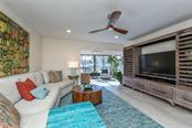Ceiling was lowered and recessed LED lighting added, creating more beautiful light in the unit. - Condo for sale at 225 Hourglass Way #208, Sarasota, FL 34242 - MLS Number is A4425323