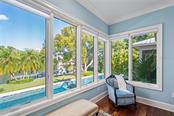 Master suite with view of water, pool & gardens. - Single Family Home for sale at 1575 Bay Point Dr, Sarasota, FL 34236 - MLS Number is A4425602