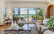 Living room with built in wet bar and magnificent views of the Gulf of Mexico - Single Family Home for sale at 121 N Casey Key Rd, Osprey, FL 34229 - MLS Number is A4425715