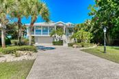 Fantastic curb appeal. Well maintained, wrap around decks to take in Florida's finest weather. - Single Family Home for sale at 737 Eagle Point Dr, Venice, FL 34285 - MLS Number is A4428917