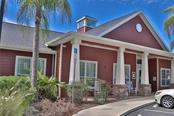 Front of Community Center - Condo for sale at 5511 Rosehill Rd #201, Sarasota, FL 34233 - MLS Number is A4431621