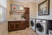 Full laundry room with immense counter space. - Single Family Home for sale at 19432 Newlane Pl, Bradenton, FL 34202 - MLS Number is A4432094