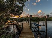 Dock at sunset - Single Family Home for sale at 1361 Bayshore Dr, Englewood, FL 34223 - MLS Number is A4433943