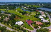Lanai is north east facing for over the golf course forever views!  Larger than typical lot...and home is positioned for maximum privacy! - Single Family Home for sale at 5401 Downham Meadows, Sarasota, FL 34235 - MLS Number is A4436577