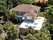 Aerial view of this magnificent home with multiple skylights. - Single Family Home for sale at 813 Hudson Ave, Sarasota, FL 34236 - MLS Number is A4437601