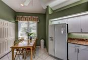 Convenient informal eating area beside the kitchen and also a generous pantry closet. - Single Family Home for sale at 8727 53rd Ter E, Bradenton, FL 34211 - MLS Number is A4447005