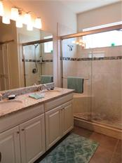 master bath with white cabinets and granite counters - Single Family Home for sale at 5727 Arbor Wood Ct, Bradenton, FL 34203 - MLS Number is A4448047