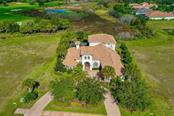 Aerial of the house frontage - Single Family Home for sale at 3719 Founders Club Dr, Sarasota, FL 34240 - MLS Number is A4455099