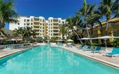 Large pool and pool deck area for the serious swimmer or for serious relaxation - Condo for sale at 100 Central Ave #A304, Sarasota, FL 34236 - MLS Number is A4458873