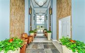 Hallway to the pool deck, social room, board room and fitness center - Condo for sale at 100 Central Ave #A401, Sarasota, FL 34236 - MLS Number is A4463296