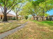 Greenbelt w/Oaks behind Villa on Rum Cay - Villa for sale at 4335 Rum Cay Cir, Sarasota, FL 34233 - MLS Number is A4463762