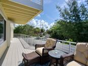 Lovely seating area for breezy relaxing nights - Single Family Home for sale at 500 Beach Rd #1, Sarasota, FL 34242 - MLS Number is A4474527