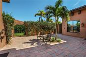 Courtyard between the office and the guest cabana. - Single Family Home for sale at 4925 Topsail Dr, Nokomis, FL 34275 - MLS Number is A4475116