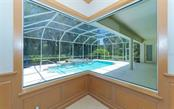 Aquarium window with view of pool - Single Family Home for sale at 462 E Macewen Dr, Osprey, FL 34229 - MLS Number is A4476181
