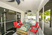 Tiki bar - gym area. - Single Family Home for sale at 7303 Westmoreland Dr, Sarasota, FL 34243 - MLS Number is A4478376