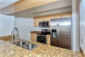 Granite counter tops and stainless steel appliances. - Condo for sale at 1064 N Tamiami Trl #1522, Sarasota, FL 34236 - MLS Number is A4479270