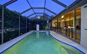Bench in heated pool - Single Family Home for sale at 9219 Bimini Dr, Bradenton, FL 34210 - MLS Number is A4483083