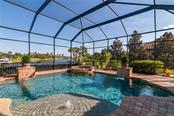 The home has a large pool with a sun deck, two water falls and a hot tub. - Single Family Home for sale at 11720 Rive Isle Run, Parrish, FL 34219 - MLS Number is A4486302