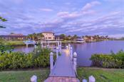 Besides accommodating your boat, the dock is a great place to watch the Manatees and Dolphins that frequent the canal. - Single Family Home for sale at 11720 Rive Isle Run, Parrish, FL 34219 - MLS Number is A4486302