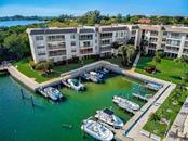 577 Sutton Place Longboat Key Florida 34228 | Boat Basin | Notice the Manatee in the Water!!! - Condo for sale at 577 Sutton Pl #T-25, Longboat Key, FL 34228 - MLS Number is A4492432