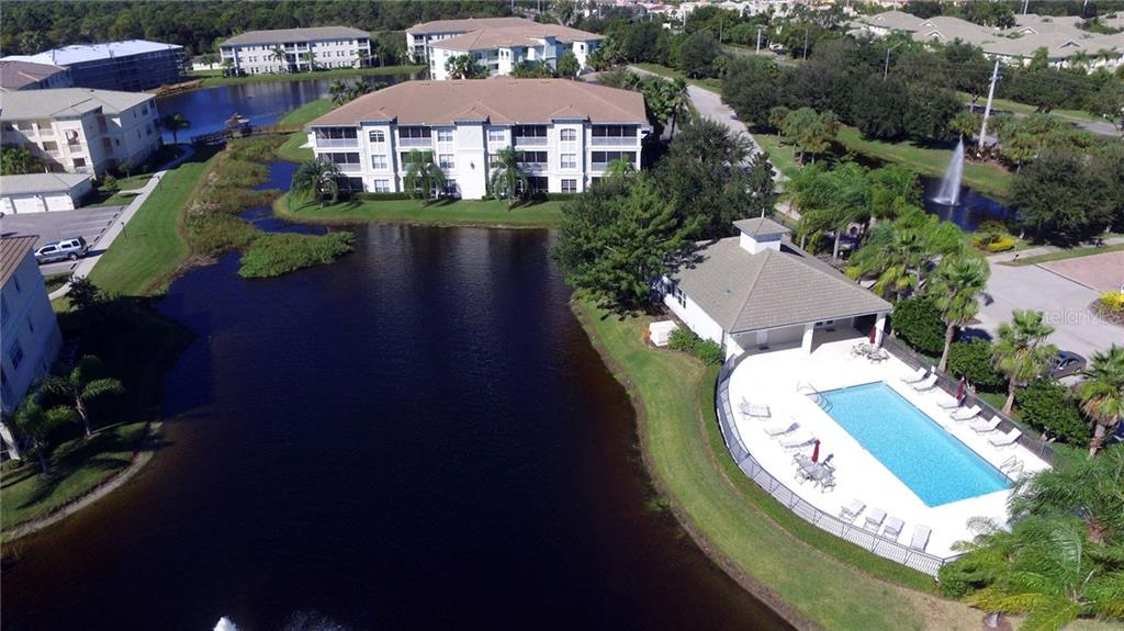 Aerial of community pool and lake. - Condo for sale at 1100 San Lino Cir #1134, Venice, FL 34292 - MLS Number is N5910364