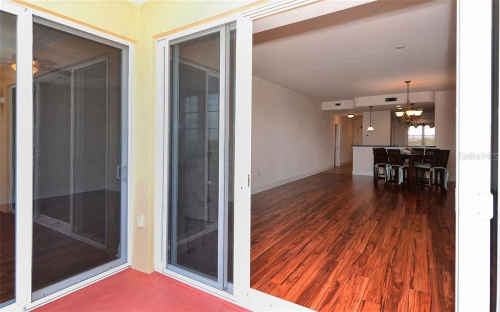 Balcony to Great Room - Condo for sale at 167 Tampa Ave E #513, Venice, FL 34285 - MLS Number is N5911190