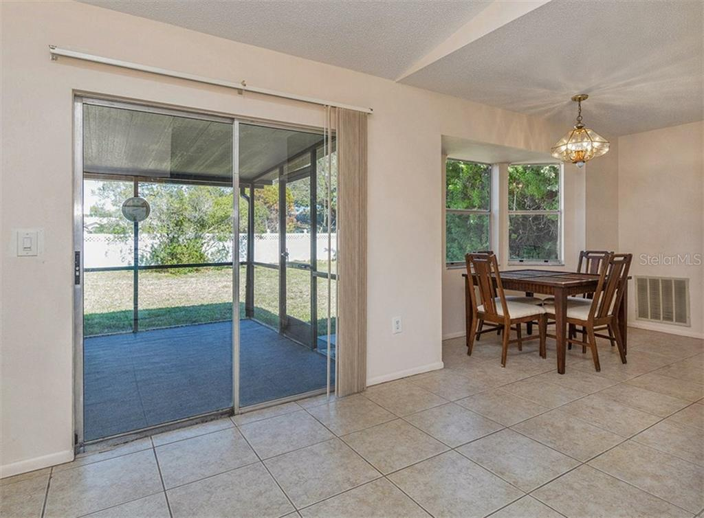 Lanai/Dining Room - Single Family Home for sale at 10308 Grail Ave, Englewood, FL 34224 - MLS Number is N5911429
