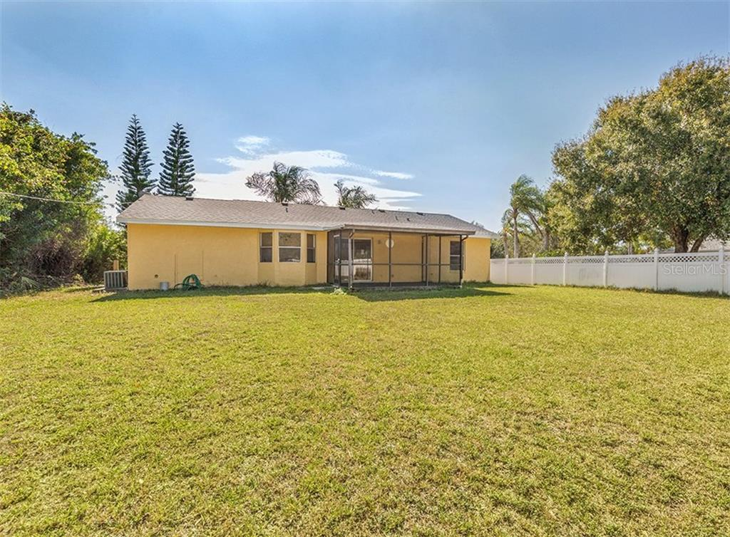 Rear Exterior - Single Family Home for sale at 10308 Grail Ave, Englewood, FL 34224 - MLS Number is N5911429