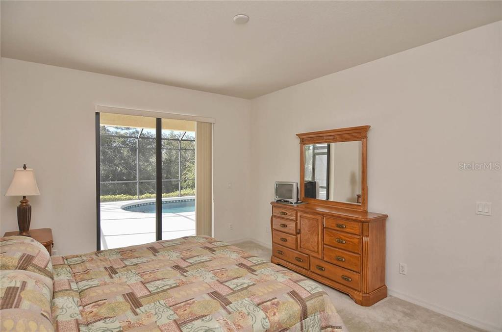 Master bedroom to lanai and pool. - Single Family Home for sale at 1975 Batello Dr, Venice, FL 34292 - MLS Number is N5911919