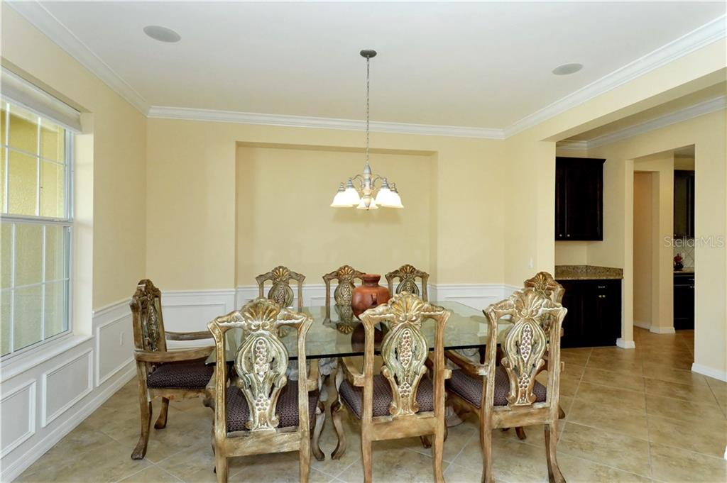 Dining room and butler's pantry - Single Family Home for sale at 19168 Jalisca St, Venice, FL 34293 - MLS Number is N5912651