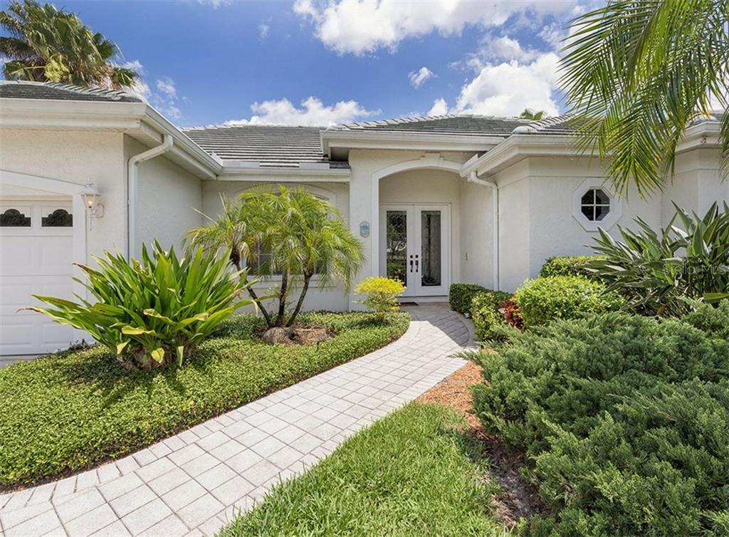 Front Entrance - Single Family Home for sale at 122 Ventana Way, Venice, FL 34292 - MLS Number is N5912714