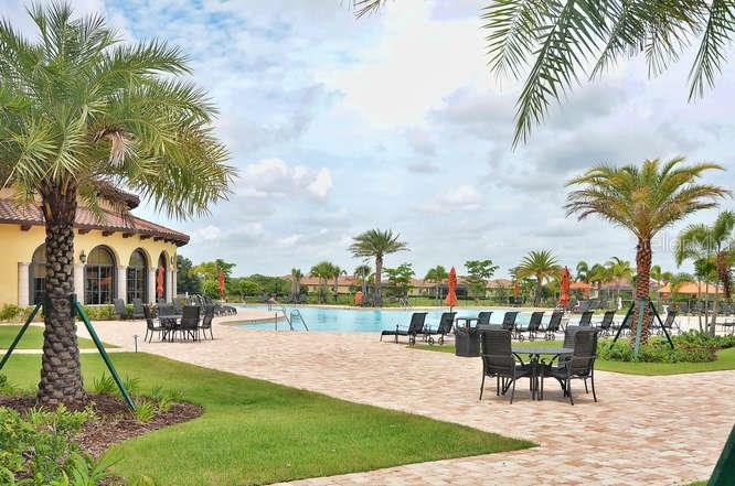 Resort style pool with plenty of seating for all. - Single Family Home for sale at 13210 Amerigo Ln, Venice, FL 34293 - MLS Number is N5913012