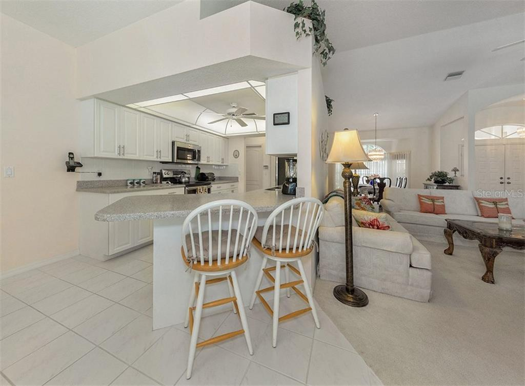 Breakfast bar/kitchen/great room - Single Family Home for sale at 577 Park Estates Sq, Venice, FL 34293 - MLS Number is N5914129