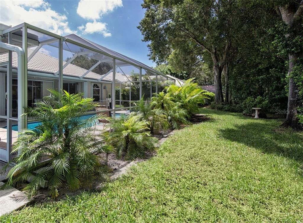 Rear exterior - Single Family Home for sale at 577 Park Estates Sq, Venice, FL 34293 - MLS Number is N5914129