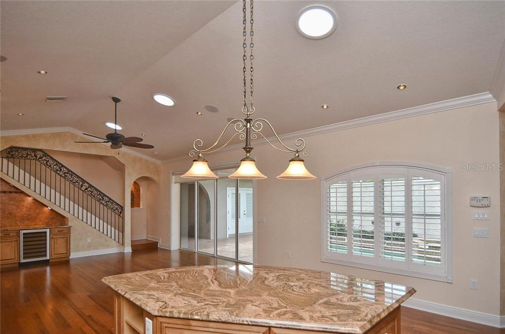 Kitchen to living room - Single Family Home for sale at 248 Pensacola Rd, Venice, FL 34285 - MLS Number is N5914299