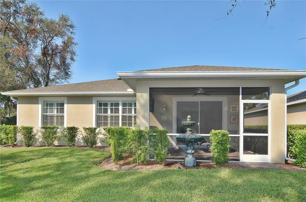 Rear exterior - Single Family Home for sale at 9124 Coachman Dr, Venice, FL 34293 - MLS Number is N5914408
