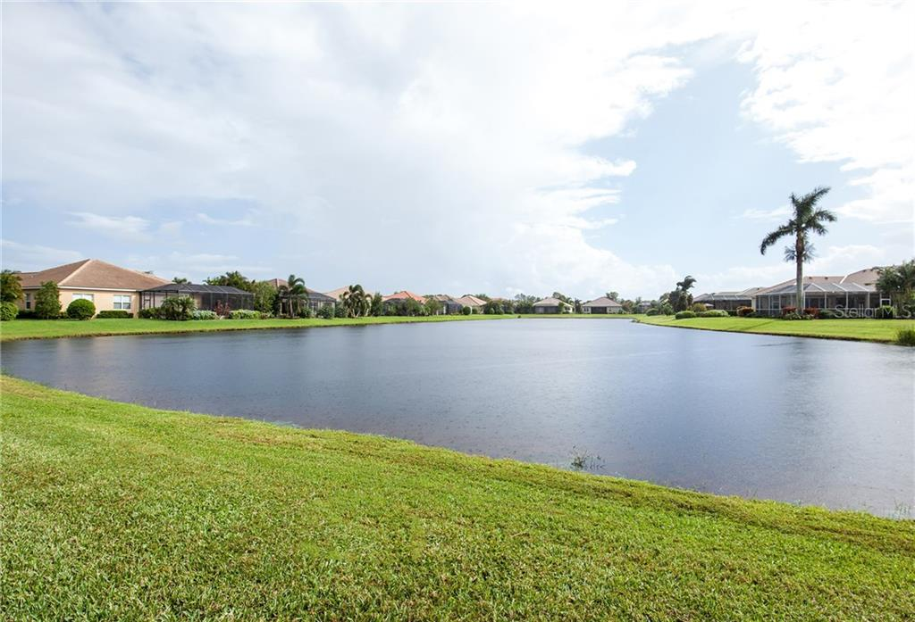 Southern Exposure with Long Lake View - Single Family Home for sale at 366 Turtleback Xing, Venice, FL 34292 - MLS Number is N5914504