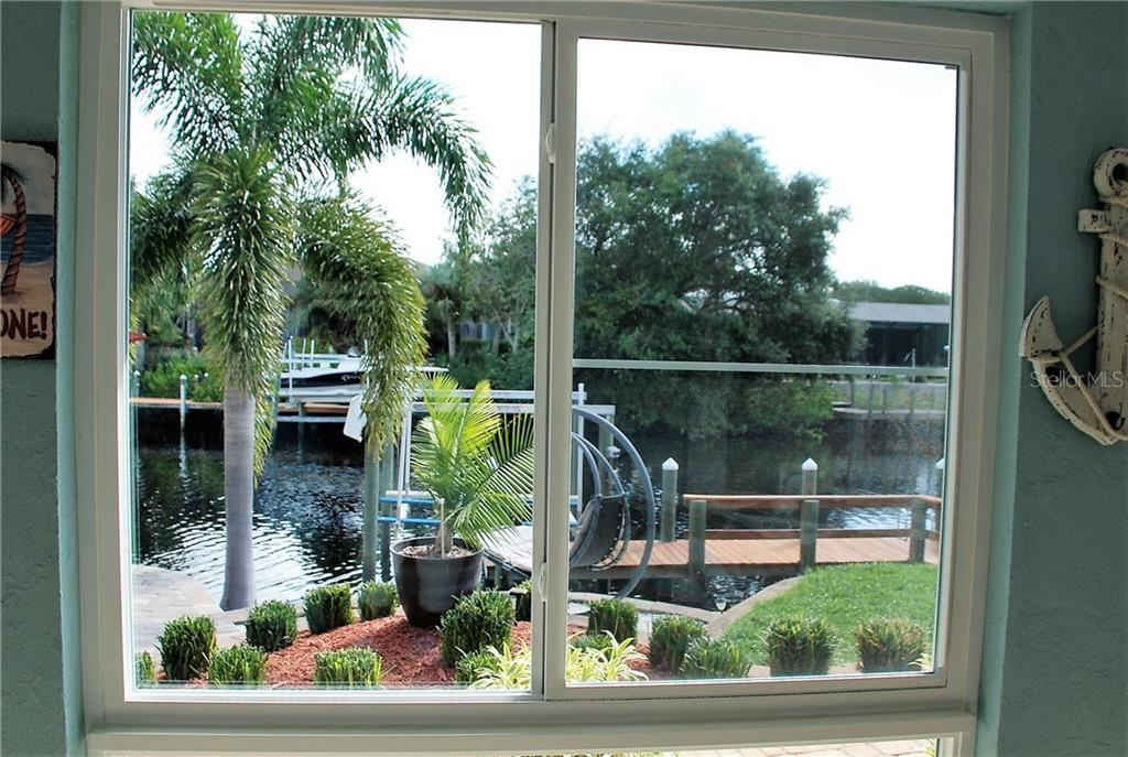 View from Florida room - Single Family Home for sale at 600 Portia St N, Nokomis, FL 34275 - MLS Number is N5914547