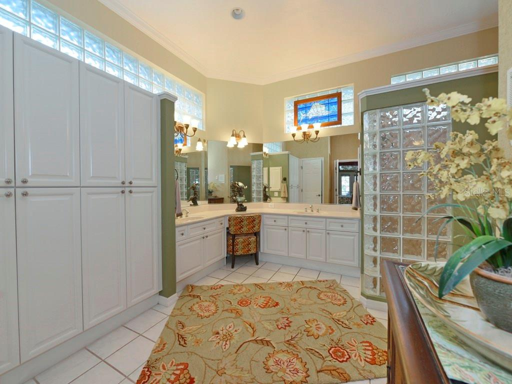 Master Bath with storage galore. - Single Family Home for sale at 200 Sunrise Dr, Nokomis, FL 34275 - MLS Number is N5914820