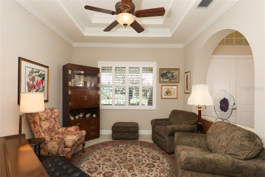 Front sitting area next to the entry door. - Single Family Home for sale at 190 Portofino Dr, North Venice, FL 34275 - MLS Number is N5915077
