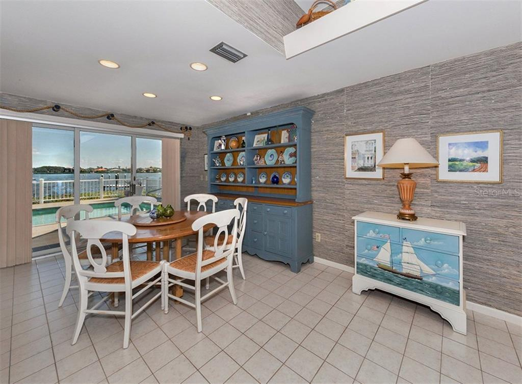 Spacious dining area offering bright dining space. - Single Family Home for sale at 3509 Casey Key Rd, Nokomis, FL 34275 - MLS Number is N5915098
