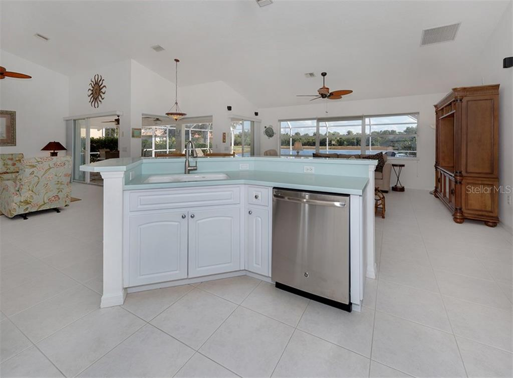Kitchen to living room, breakfast nook, family room - Single Family Home for sale at 866 Wood Sorrel Ln, Venice, FL 34293 - MLS Number is N5915362