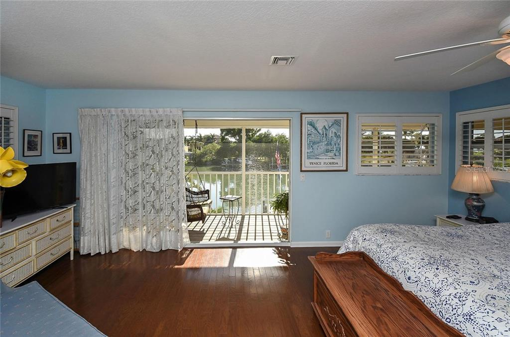 Master bedroom with bay view - Single Family Home for sale at 910 Casey Cove Dr, Nokomis, FL 34275 - MLS Number is N5915385