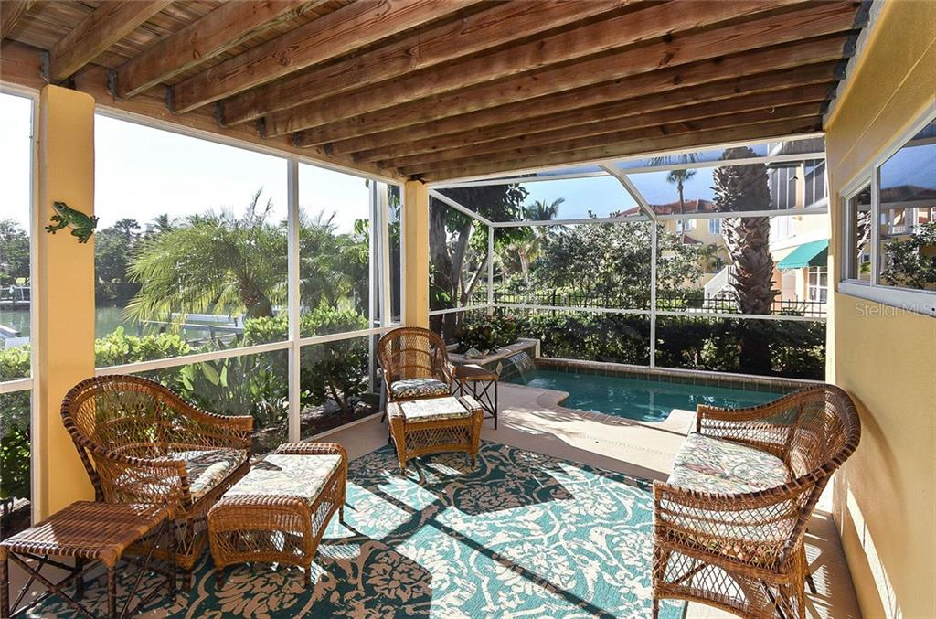 Lanai to pool - Single Family Home for sale at 910 Casey Cove Dr, Nokomis, FL 34275 - MLS Number is N5915385