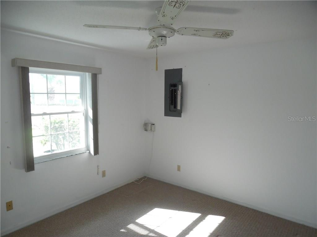 bedroom #2 has a sliding door to the pool area - Single Family Home for sale at 441 Baynard Dr, Venice, FL 34285 - MLS Number is N5915507