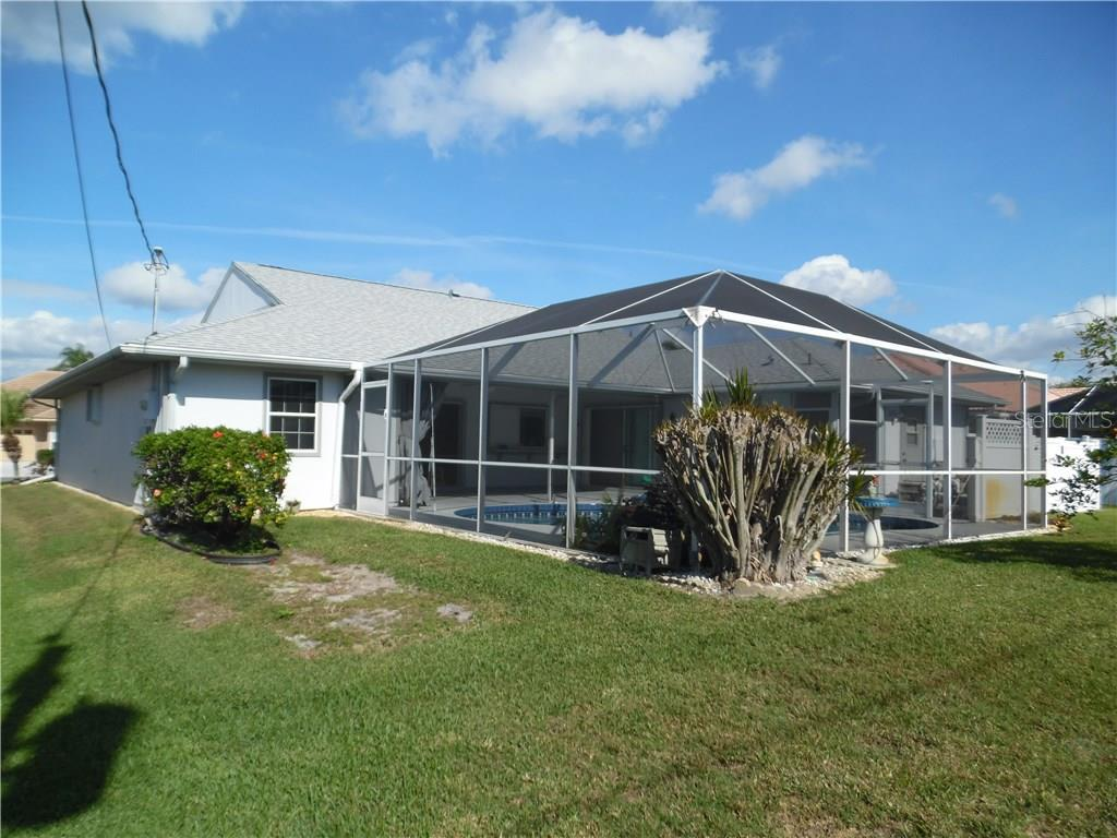 back of house, southwest corner - Single Family Home for sale at 441 Baynard Dr, Venice, FL 34285 - MLS Number is N5915507