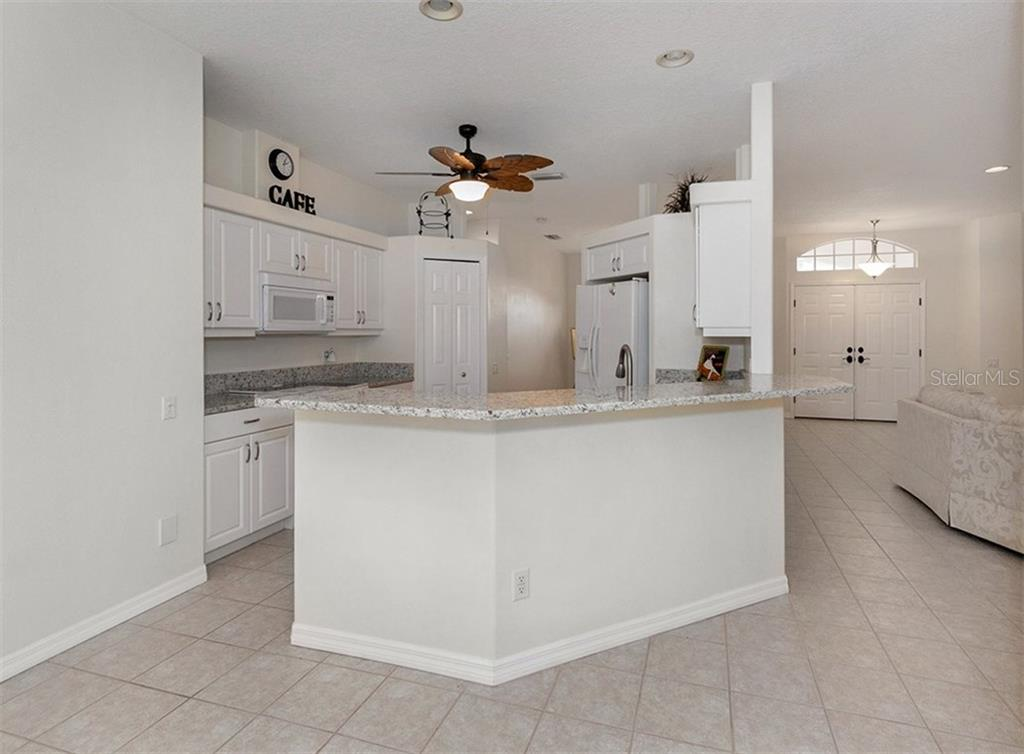 Kitchen with breakfast bar - Single Family Home for sale at 2196 Calusa Lakes Blvd, Nokomis, FL 34275 - MLS Number is N5915879