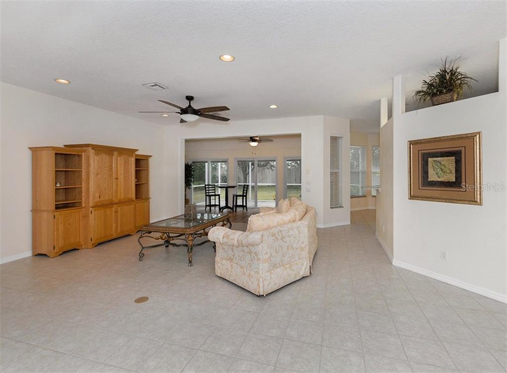 Living room - Single Family Home for sale at 2196 Calusa Lakes Blvd, Nokomis, FL 34275 - MLS Number is N5915879