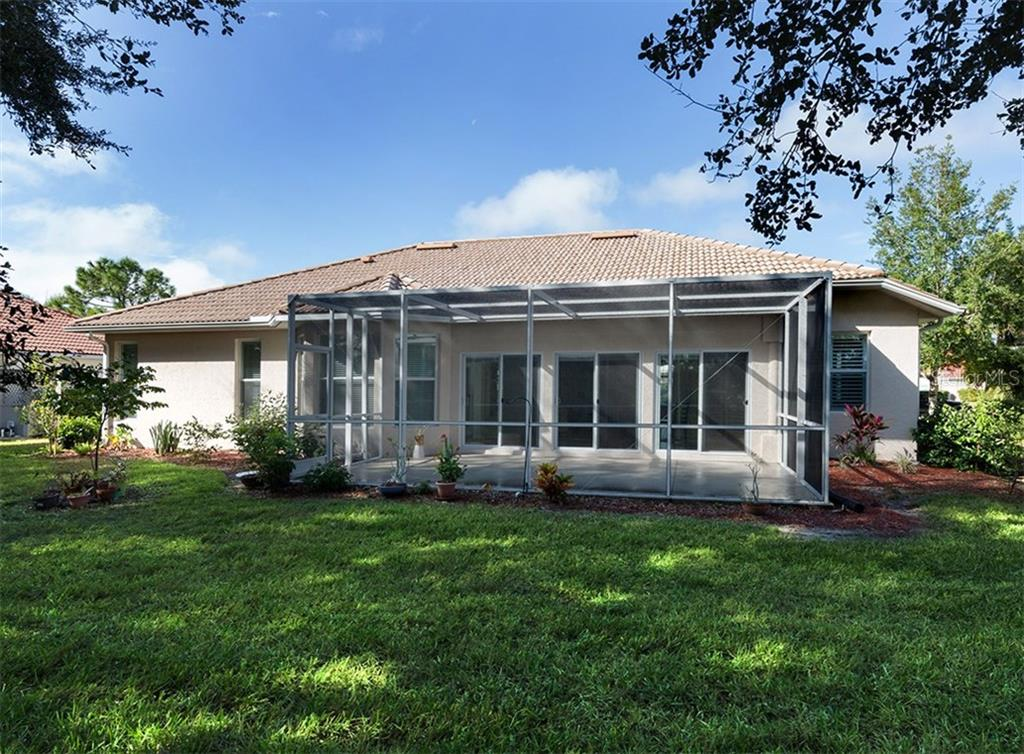 Rear exterior - Single Family Home for sale at 2196 Calusa Lakes Blvd, Nokomis, FL 34275 - MLS Number is N5915879